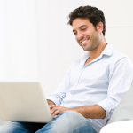 Man smiling as he checks he email