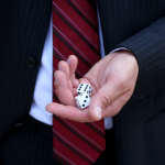 Man in suit rolling dice