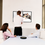 Three people participating in a video meeting over the Internet